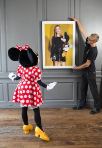 EDITORIAL USE ONLY Minnie Mouse watches as artwork in hung at Blacks Club in London, ahead of the opening of new exhibition, Minnie: Style Icon, in partnership with the British Fashion Council, which will be on display at the Soho venue during London Fashion Week. PRESS ASSOCIATION Photo. Picture date: Thursday September 17, 2015. The exhibition of exclusive photographs, exploring the character of Disney's Minnie Mouse and her influence on fashion and pop culture, has been curated with the help of model and photographer, Georgia May Jagger. Photo credit should read: David Parry/PA Wire